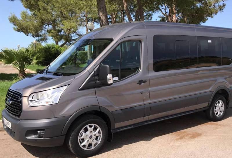 Hire private minibus to club Cala Marsal
